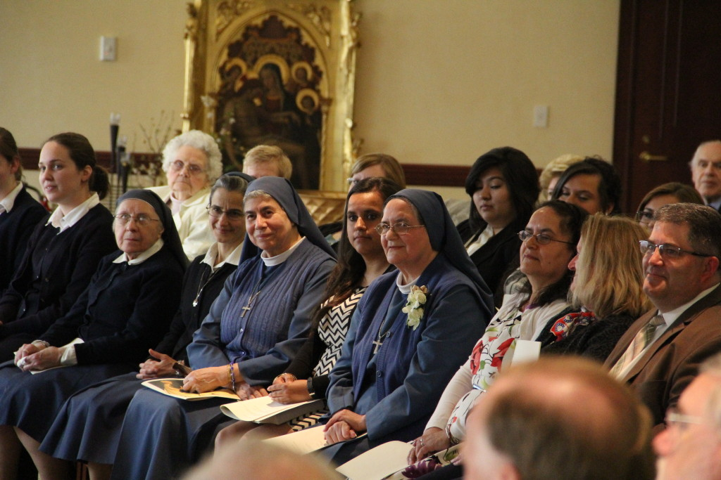 Sr. Michelle seated in the front row at the Mass at Bethany Chapel of the Pastoral Center.