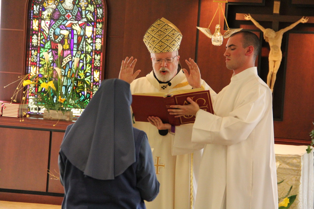 Sr. Michelle receiving a blessing from Cardinal Sean O'Malley