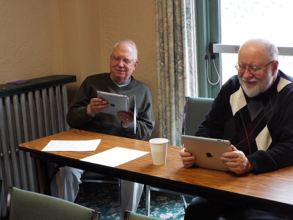 Brother Edward and Fr. Jeff taking notes on their Tablets