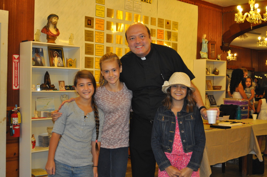 Fr. Mike and some of the children, Malia, Sarah and Christina of the retreat