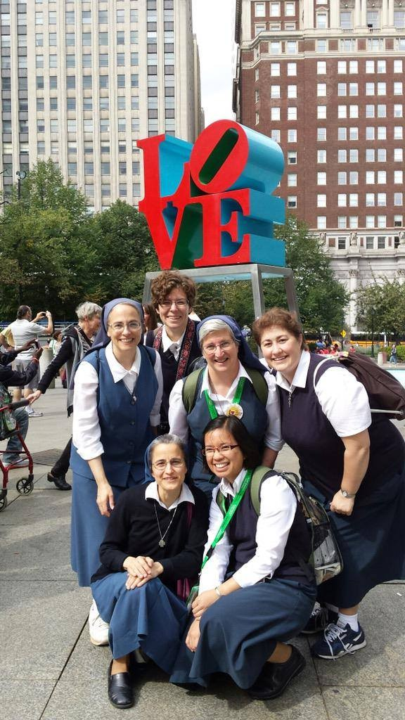 "Daughters of St. Paul at the ""Love"" sign in Philadelphia"