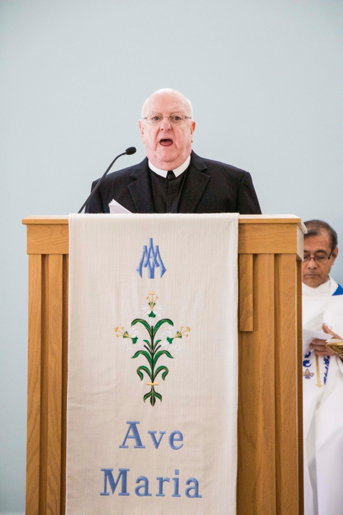 Brother Gus Condon offers the Second Reading