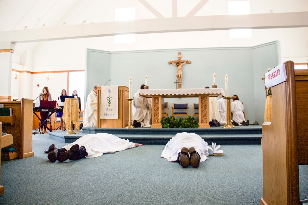Fr. Michael Harrington and Fr. Edward Riley lying prostrate on the Chapel floor during the Litany of the Saints